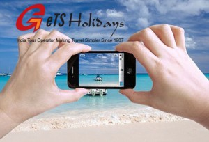 Close up photo of a female tourist taking photos of a beautiful beach in The Bahamas with her iPhone 4 camera