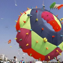 Ahmedabad: A kite master flying a huge kite during International Kite festival at Sabarmati river front in Ahmedabad on Tuesday. PTI Photo    (PTI1_12_2016_000270B)