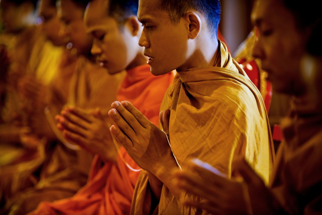 Buddhist Monks Praying at a Monastery